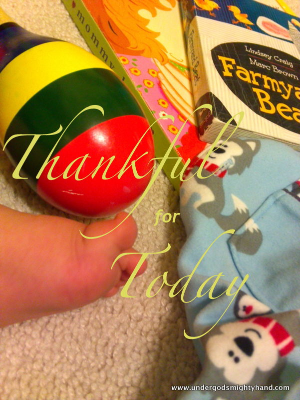 Thankful for Today - baby foot, musical instrument, books, pajamas - all part of a normal day
